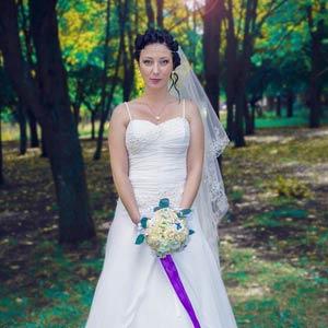 Happy bride in wedding dress